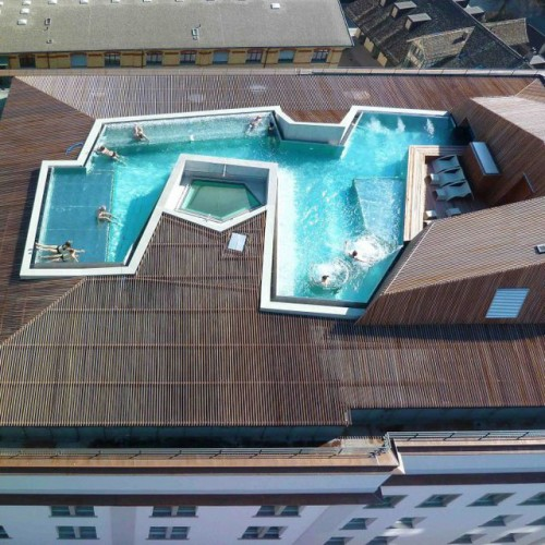 Hotel with swimming pool on the roof showme design for Rooftop pool design