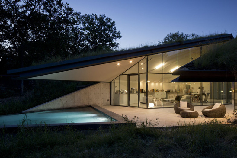 house-built-into-hill-moonlit-pool