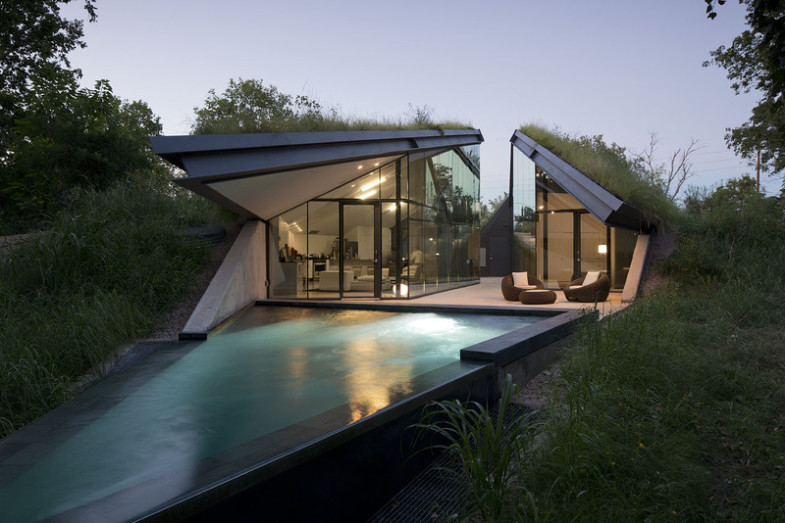 house-built-into-hill-moonlit-pool-front